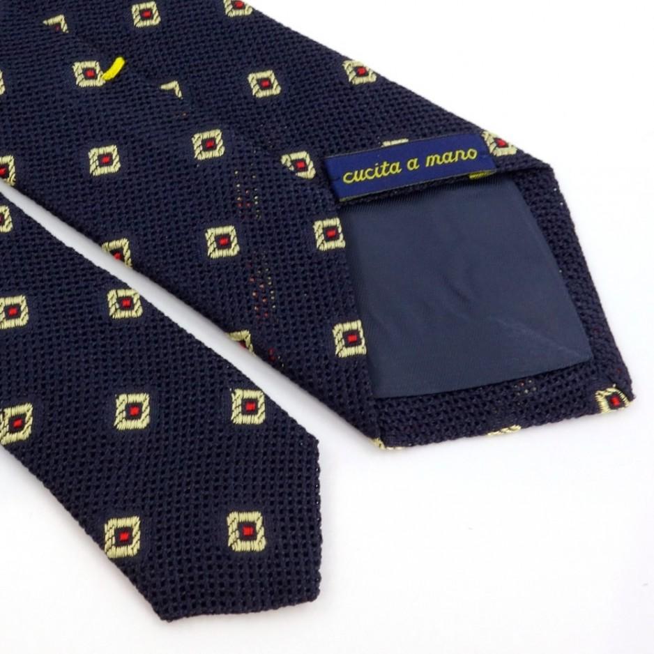 Cravate bleue à motif jacquard rouge et doré