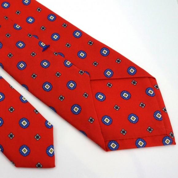 Cravate rouge en soie à petits motifs imprimés