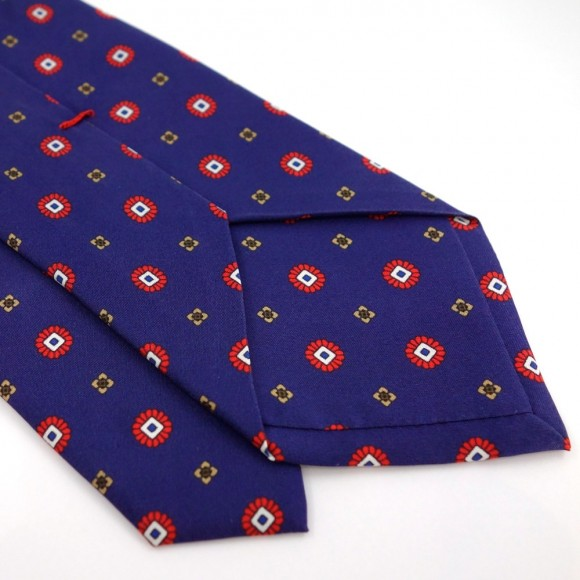 Cravate bleue en soie à petits imprimés rouges et jaunes